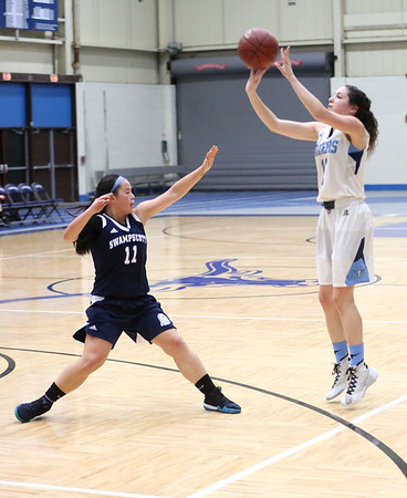 HADLEY GREEN/Staff photo<br /> Peabody's Serena Laro (11) shoots while Swampscott's Katie Watts (11) plays defense at the Peabody v. Swampscott girls basketball game at Peabody High School.<br /> <br /> 02/15/18