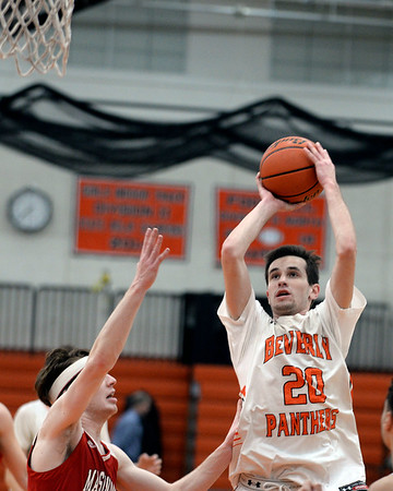 RYAN HUTTON/ Staff photo<br /> Beverly's Luigi Derrane puts up a shot on the MASCo net during the second quarter of the Larry McIntire Classic at Beverly High School on Monday.
