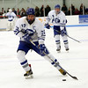 HADLEY GREEN/Staff photo<br /> Danvers' Thomas Mento (22) lines up his shot at the Danvers v. Gloucester boys hockey game at Endicott College.<br /> <br /> 02/09/18