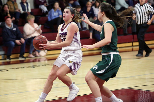 HADLEY GREEN/Staff photo<br /> Rockport's Kylie Schrock (15) runs towards the basket while Manchester-Essex's Grace Brennan (4) plays defense at the Rockport v. Manchester-Essex girls basketball game at Rockport High School. <br /> <br /> 02/16/18