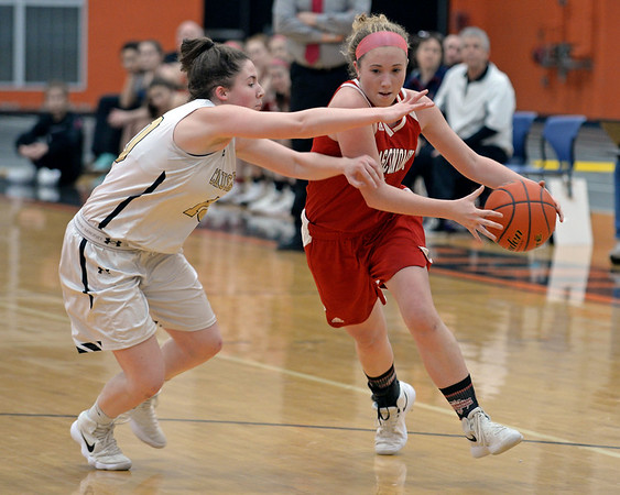 RYAN HUTTON/ Staff photo<br /> MASCO's Morgan Bovardi tries to drive around Bishop Fenwick's Courtney Norton during the second quarter of the Larry MacIntire Tournament final on Monday at Beverly High School.