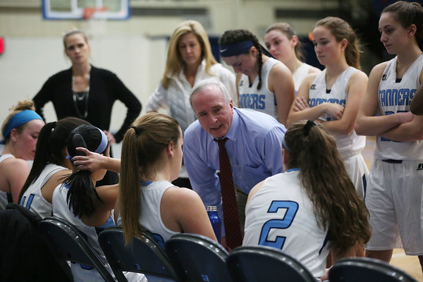 HADLEY GREEN/Staff photo<br /> Peabody coach Stan McKeen speaks to his team during a timeout at the Peabody v. Everett girls basketball game at Peabody High School.<br /> <br /> 02/08/18
