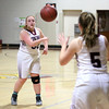 HADLEY GREEN/Staff photo<br /> Rockport's Lauren Ryan (33) passes the ball to her teammate Charlotte Salmon (5) at the Rockport v. Manchester-Essex girls basketball game at Rockport High School. <br /> <br /> 02/16/18