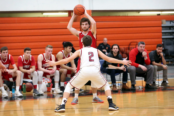HADLEY GREEN/Staff photo<br /> Masconomet's Daniel Monagle (10) looks for an open pass while Gloucester's Benjamin Oliver (2) guards him at the Gloucester v. Masconomet boys basketball game at Beverly High School.<br /> <br /> 02/18/18