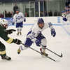 HADLEY GREEN/Staff photo<br /> Danvers' Thomas Mento (22) skates towards the puck at the Danvers v. North Reading boys hockey game at Endicott College. <br /> <br /> 02/23/18