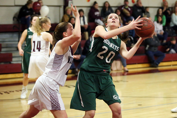 HADLEY GREEN/Staff photo<br /> Manchester-Essex's Emily Jacobsen (20) shoots while Rockport's Jordan Fears (4) plays defense at the Rockport v. Manchester-Essex girls basketball game at Rockport High School. <br /> <br /> 02/16/18