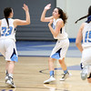 HADLEY GREEN/Staff photo<br /> Peabody's Serena Laro (11) and Jordan Muse (33) high five after Laro scores at the Peabody v. Swampscott girls basketball game at Peabody High School.<br /> <br /> 02/15/18