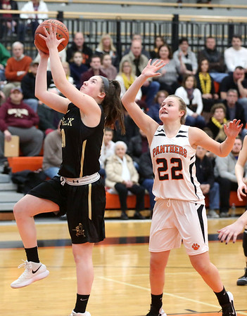 HADLEY GREEN/Staff photo<br /> Bishop Fenwick's Courtney Norton (10) shoots while Beverly's Tia Bernard (22) plays defense at the Beverly v. Bishop Fenwick girls basketball game at Beverly High School.<br /> <br /> 02/18/18