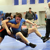 HADLEY GREEN/Staff photo<br /> Beverly's Ameer Alshrafi wrestles Danvers' Rob Murphy at the Division 2 North wrestling sectionals at Danvers High School.<br /> <br /> 02/10/18