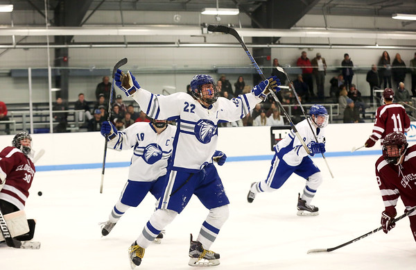 HADLEY GREEN/Staff photo<br /> Danvers' Thomas Mento (22) celebrates after his team scores at the Danvers v. Gloucester boys hockey game at Endicott College.<br /> <br /> 02/09/18