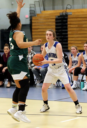 HADLEY GREEN/Staff photo<br /> Danvers' Siobhan Moriarty (5) looks for an open pass while Lynn Classical's Tyarah Horton (35) guards her at the Danvers v. Lynn Classical girls basketball game at Danvers High School.<br /> <br /> 02/06/18
