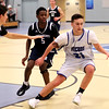 HADLEY GREEN/Staff photo<br /> Danvers' Justin Roberto (21) dribbles while Swampscott's Jake Goldman (4) and Max Pegnato (24) play defense at the Danvers v. Swampscott boys basketball game at Danvers High School.<br /> <br /> 02/13/18