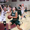 HADLEY GREEN/Staff photo<br /> Manchester-Essex's Isabella Pomeroy (10) moves the ball towards the basket while Rockport's Charlotte Salmon (5) plays defense at the Rockport v. Manchester-Essex girls basketball game at Rockport High School. <br /> <br /> 02/16/18