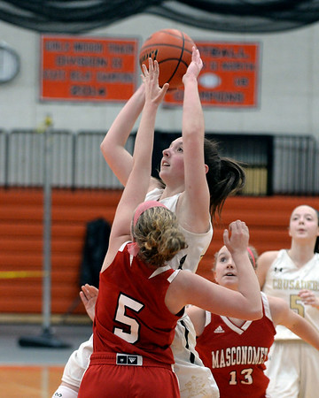 RYAN HUTTON/ Staff photo<br /> Bishop Fenwick's Liz Gonzalez goes up to the hoop as MASCO's Paige Amyouny leaps to block during the second quarter of the Larry MacIntire Tournament final on Monday at Beverly High School.