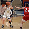RYAN HUTTON/ Staff photo<br /> Bishop Fenwick's Jaxson Nadeau looks for an open teammate to pass to as MASCO's Cally McSweeney looks to block during the second quarter of the Larry MacIntire Tournament final on Monday at Beverly High School.