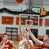 RYAN HUTTON/ Staff photo<br /> Beverly's Jack Crowley puts up a shot on the MASCO net during the second quarter of the Larry McIntire Classic at Beverly High School on Monday.