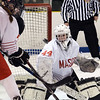 CARL RUSSO/Staff photo. Masco.'s goalie, Molly Elmore keeps her eye on the puck after making the save. Masconomet vs. Marblehead in girls hockey Division 1 preliminary round playoff game. 2/27/2018