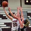 HADLEY GREEN/Staff photo<br /> Gloucester's Whitney Schrock (20) scores at the Gloucester v. Malden girls basketball game at Gloucester High School.<br /> <br /> 02/02/18