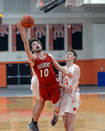 RYAN HUTTON/ Staff photo<br /> MASCO's Daniel Monagle goes up to the Beverly hoop during the first quarter of the Larry McIntire Classic at Beverly High School on Monday.