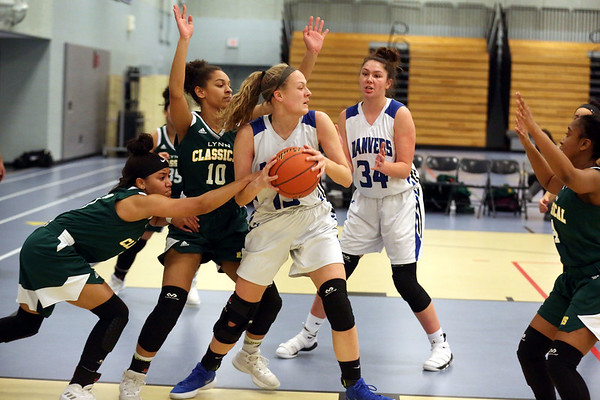 HADLEY GREEN/Staff photo<br /> Danvers' Sarah Unczur (15) comes down with the rebound aided by teammate Cheyenne Nessinger (34) while Lynn Classical's Jeylly Medrano (3) and Skyler Crayton (10) play defense at the Danvers v. Lynn Classical girls basketball game at Danvers High School.<br /> <br /> 02/06/18