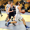 HADLEY GREEN/Staff photo<br /> Danvers' Edward Vaillancourt (5) shoots while Swampscott's Jackson Byrne (11) plays defense at the Danvers v. Swampscott boys basketball game at Danvers High School.<br /> <br /> 02/13/18