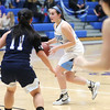 HADLEY GREEN/Staff photo<br /> Peabody's Jordan Muse (33) dribbles while Swampscott's Katie Watts (11) plays defense at the Peabody v. Swampscott girls basketball game at Peabody High School.<br /> <br /> 02/15/18