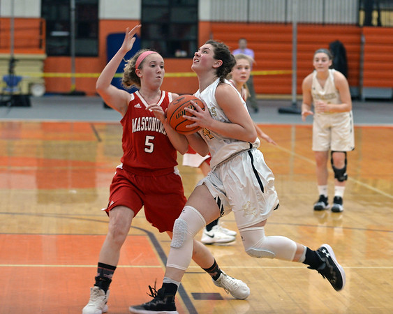 RYAN HUTTON/ Staff photo<br /> Bishop Fenwick's Olivia DiPietro drives to the MASCO hoop past defender Paige Amyouny during the second quarter of the Larry MacIntire Tournament final on Monday at Beverly High School.