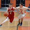 RYAN HUTTON/ Staff photo<br /> MASCO's Colby Jacques drives downcourt against Beverly's Luigi Derrane during the first quarter of the Larry McIntire Classic at Beverly High School on Monday.