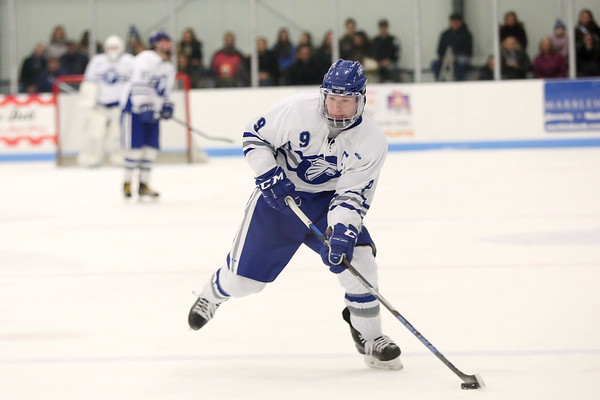 HADLEY GREEN/Staff photo<br /> Danvers' Conor Purtell (9) lines up his shot at the Danvers v. North Reading boys hockey game at Endicott College. <br /> <br /> 02/23/18