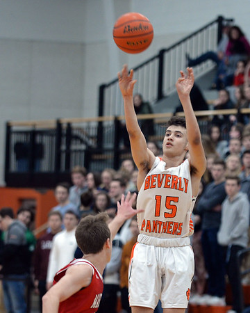 RYAN HUTTON/ Staff photo<br /> Beverly's Toskany Abreu puts up a shot on the MASCO hoop during the second quarter of the Larry McIntire Classic at Beverly High School on Monday.
