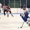 HADLEY GREEN/Staff photo<br /> Danvers' Matthew Taylor (19) moves the puck at the Danvers v. Gloucester boys hockey game at Endicott College.<br /> <br /> 02/09/18