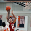 RYAN HUTTON/ Staff photo<br /> MASCO's Nicholas Mangino puts up a shot on the Beverly hoop during the first quarter of the Larry McIntire Classic at Beverly High School on Monday.