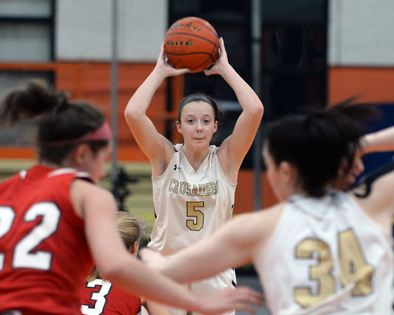 RYAN HUTTON/ Staff photo<br /> Bishop Fenwick's Sammi Gallant looks for an open teammate to pass to during the second quarter of the Larry MacIntire Tournament final against MASCO on Monday at Beverly High School.