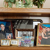 Family photos on a shelf at the Harris residence including Jennifer's fiancee. (please double check they were engaged) Jared Charney / Photo