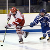 CARL RUSSO/Staff photo SALEM NEWS: Danver's captain, Matthew Taylor is unable to stop Masconomet's William Major as he breaks away to score the Chieftains 4th. goal of the game at the start of the second period in Hockey action. Masconomet high school vs Danvers high school in boys varsity hockey action. 2/12/2018