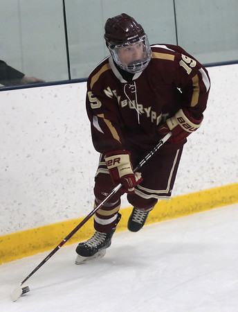 HADLEY GREEN/Staff photo<br /> Newburyport's Cole Spence (19) moves the puck at the 10th annual Derek Hines Memorial Game at the Essex Sports Center. <br /> <br /> 02/10/18