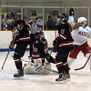 CARL RUSSO/Staff photo. Masco.'s captain, Kate Irons, right, celebrates after scoring the first goal of the game. Masconomet vs. Marblehead in girls hockey Division 1 preliminary round playoff game.  2/27/2018