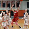 RYAN HUTTON/ Staff photo<br /> MASCO's Makayla Graves puts up a shot on the Bishop Fenwick net during the first quarter of the Larry MacIntire Tournament final on Monday at Beverly High School.