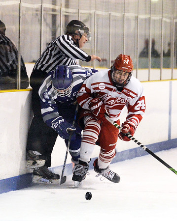 CARL RUSSO/Staff photo SALEM NEWS: An official gets caught up in the action as Danver's Jack Thibodeau and Masconomet's captain, Andrew Gotts, 24, battle for the puck along the boards. Masconomet high school vs Danvers high school in boys varsity hockey action. 2/12/2018