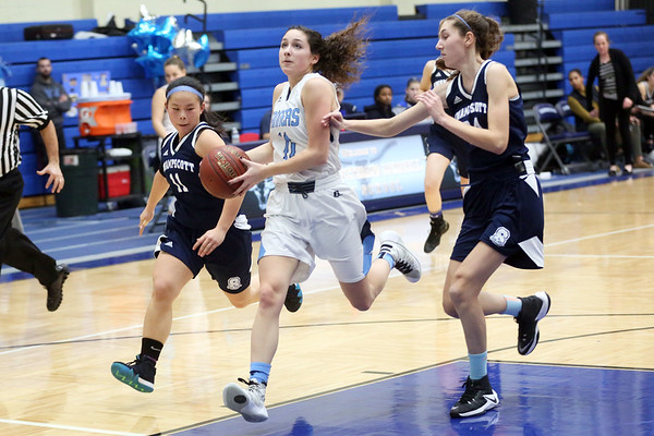 HADLEY GREEN/Staff photo<br /> Peabody's Serena Laro (11) dribbles to the basket while Swampscott's Katie Watts (11) and Ella Sprague (24) defend her at the Peabody v. Swampscott girls basketball game at Peabody High School.<br /> <br /> 02/15/18