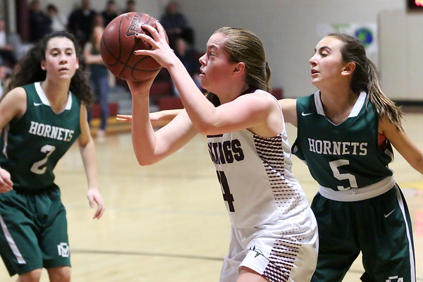 HADLEY GREEN/Staff photo<br /> Rockport's Jordan Fears (4) shoots at the Rockport v. Manchester-Essex girls basketball game at Rockport High School. <br /> <br /> 02/16/18