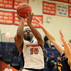 HADLEY GREEN/Staff photo<br /> Salem State's Rayshaw Matthews (10) shoots at the Salem State v. MCLA boys basketball game at Salem State University.<br /> <br /> 02/14/18