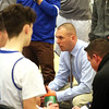 HADLEY GREEN/Staff photo<br /> Danvers coach Christopher Timson speaks to his players during a time out at the Danvers v. Swampscott boys basketball game at Danvers High School.<br /> <br /> 02/13/18