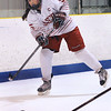 CARL RUSSO/Staff photo. Masco.'s captain, Riane Vatcher clears the puck.  Masconomet vs. Marblehead in girls hockey Division 1 preliminary round playoff game.  2/27/2018