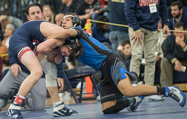 AMANDA SABGA/Staff photo<br /> <br /> Danvers' Max Leete's grabs onto Central Catholic's Mike Glynn during the 120 weight class championship at the MIAA all-state wrestling meet at St. John's Prep in Danvers. <br /> <br /> 2/23/19