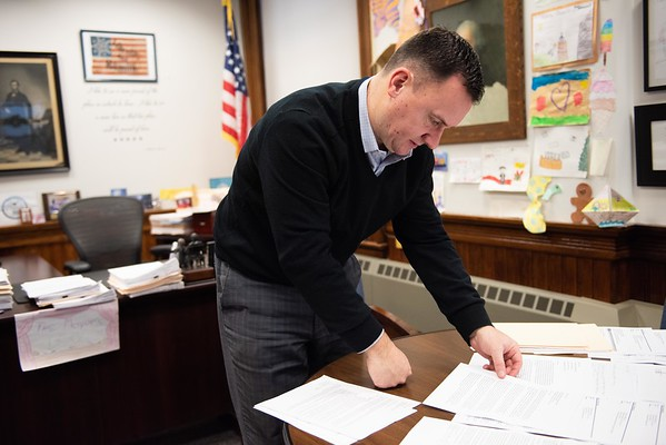 Mayor Ted Bettencourt looks at written letters opposing the 40B project at the former J.B Thomas Curahealth hospital site on 15 King Street. RYAN MCBRIDE/Staff photo 2/13/20