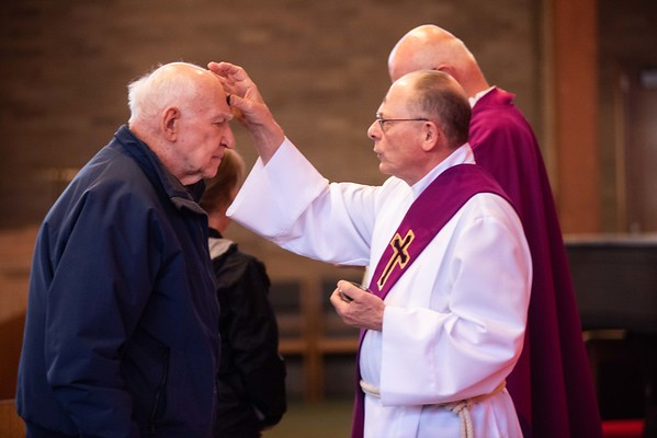 Paul Guinivan, of Danvers, receives his ashes. Parishioners attend mass and receive their ashes on Ash Wednesday at St. Richard Parish in Danvers. RYAN MCBRIDE/Staff photo 2/26/20