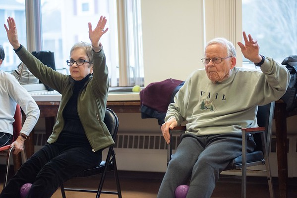 Anne Austin, left, and Rowe Austin, right, of Marblehead, stretch their arms. Strength in Motion, the Parkinson's Fitness class runs every Tuesday from 11:00 AM to Noon at the Marblehead Council on Aging. RYAN MCBRIDE/Staff photo 2/25/20