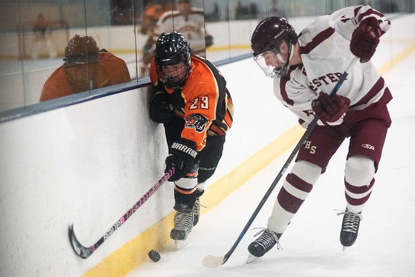 Beverly's Andrew Mezza fights for possession with Gloucester's Tim Marrone brings the puck up ice. Gloucester hosted Beverly at the Talbot Rink, routing the Panthers 7-1. RYAN MCBRIDE/Staff photo 2/15/20