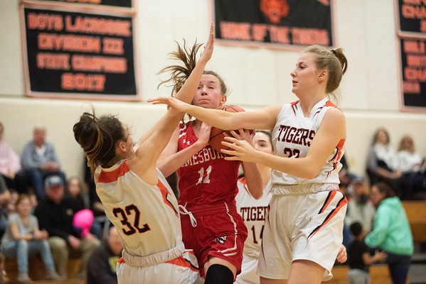 Amesbury's Avery Hallinan is double teamed by Ipswich's Riley Daly, left, and Julia Moseley, right. Ipswich hosted the Amesbury Indians Thursday evening. RYAN MCBRIDE/Staff photo 2/13/20